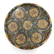 A Moroccan charger with geometric designs, vignettes with six point star detail and Islamic