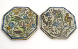 Two Persian tiles of octagonal form decorated with stylised birds and flowers within a blue