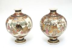 A pair of Japanese Satsuma vases of globular form in the Kutani style with flared rims and feet. The