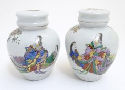 A pair of Oriental spice jars with lids and covers with hand painted decoration depicting two female