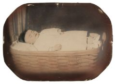 * Post-mortem of a child. A full-length portrait of a young child lying in a wicker basket, c. 1880s