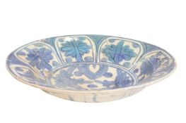 ISLAMIC BLUE AND WHITE GLAZED POTTERY DISH, 16TH CENTURY
