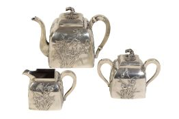 CHINESE EXPORT THREE PIECE SILVER TEA SERVICE, MARK OF WANG HING & CO.