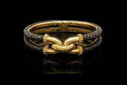 A VINTAGE BOUCHERON PARIS BRONZE AIRAIN AND 18CT YELLOW GOLD BANGLE