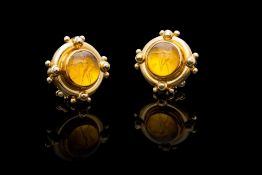 A PAIR OF 18CT YELLOW GOLD AND HAND CARVED CITRINE EARRINGS BY ELIZABETH LOCKE