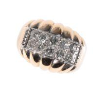 A GENTLEMAN'S MODERINST DIAMOND CLUSTER RING