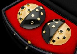 A PAIR OF 1960S MORSE BROS 14CT YELLOW GOLD AND BLACK ENAMEL POLKA DOT EARRINGS