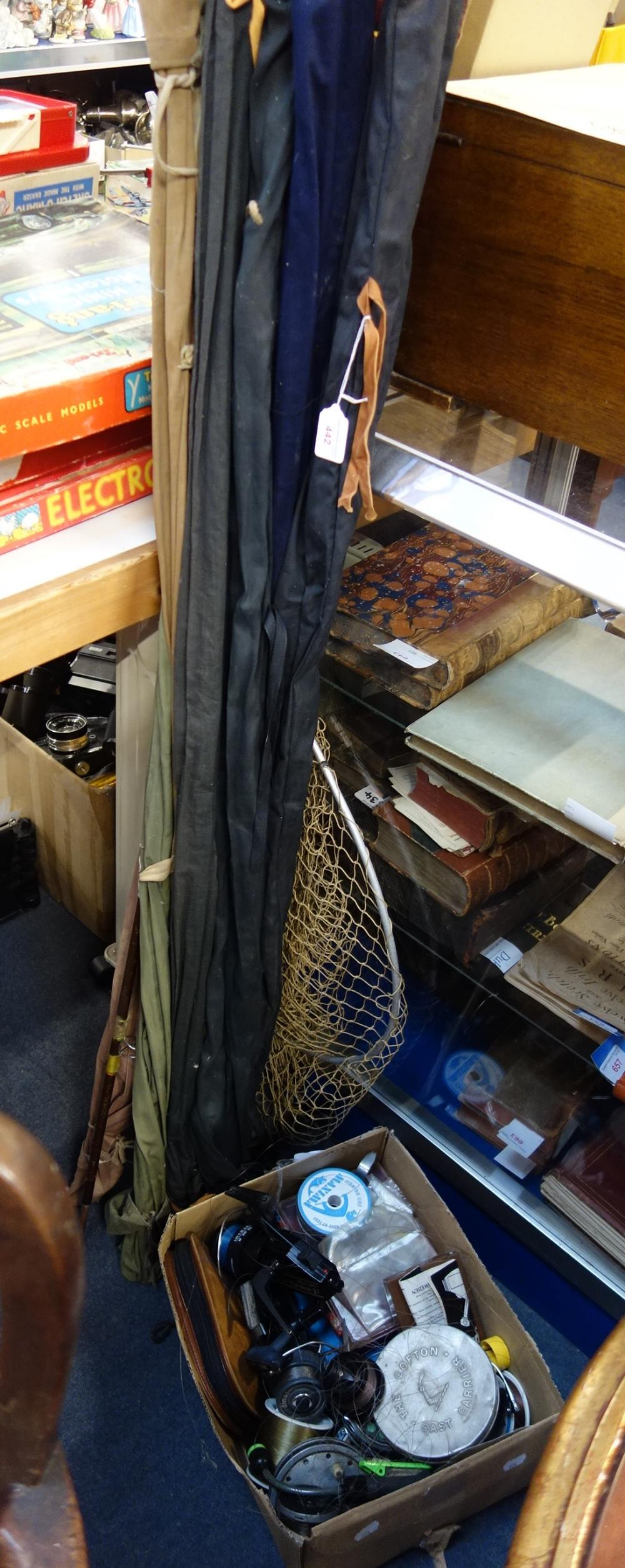 Lot 442 - A COLLECTION OF VINTAGE FISHING RODS, a collection of reels and a net