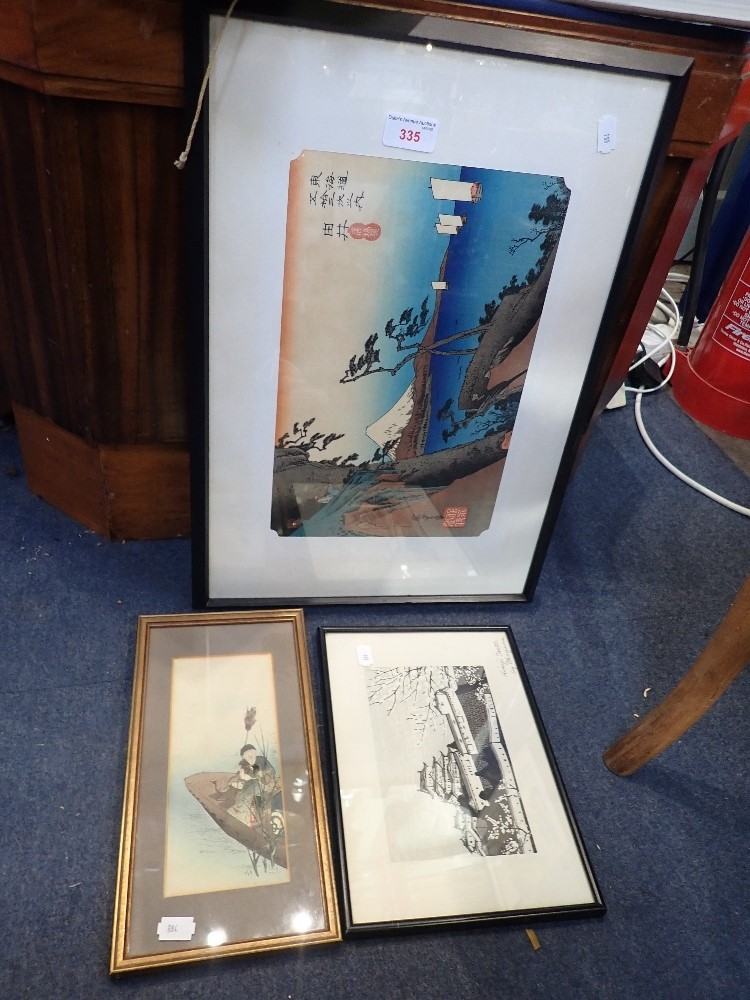 Lot 335 - A SIGNED JAPANESE WOODCUT OF A COASTAL SCENE, looking towards Mount Fuji, and two similar prints (