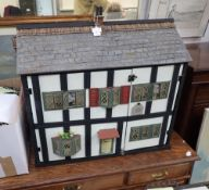 AN EXTENSIVELY RESTORED AND FURNISHED TRIANG DOLLS HOUSE