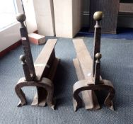 A PAIR OF LARGE IRON AND BRASS FIREDOGS