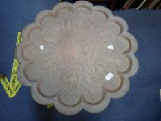 A BRASS-TOPPED PERSIAN TABLE