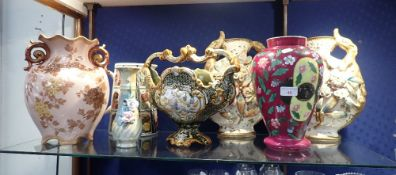 A PAIR OF VICTORIAN FLOWER ENCRUSTED VASES