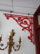 A PAIR OF LARGE CAST IRON BRACKETS