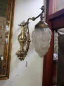 AN EARLY 20TH CENTURY BRASS AND NICKEL PLATED ART NOUVEAU WALL LIGHT