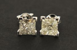 Pair of 18ct white gold princess cut diamond stud earrings, approximately 3 carats in total, 2.