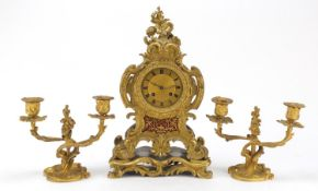 19th century French Ormolu acanthus design mantle clock with two branch candlestick garnitures,