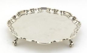 Atkin Brothers, Georgian style silver salver raised on four scroll feet, Sheffield 1935, 20.5cm in