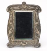 William Neale & Sons, Art Nouveau silver easel mirror with bevelled glass, embossed with stylised