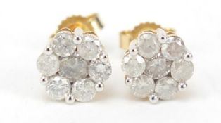 Pair of 9ct gold diamond flower head earrings, approximately 1 carat in total, 1.5g : For Further