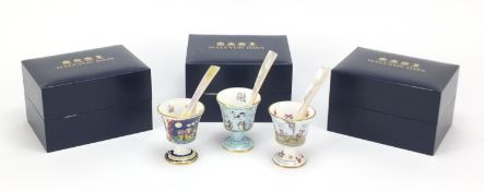 Three Halcyon Days nursery rhyme egg cups with mother of pearl spoons and boxes, 7cm high
