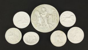 Seven Italian Grand Tour plaster cameos, the largest 7.5cm in diameter