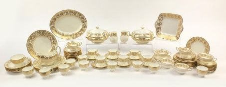 Wedgwood Gold Damask dinner and teaware including two lidded tureens, gravy boat and stand, meat
