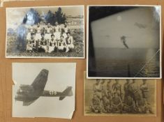 Two albums of black and white postcards including military examples