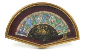 Chinese brisé fan with black lacquered sticks and guards, hand painted and gilded with figures in