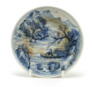 Chinese blue and white porcelain shallow dish hand painted with fishermen in a mountain landscape,