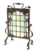 Arts & Crafts wrought iron and copper fruit design firescreen with leaded clear and coloured glass