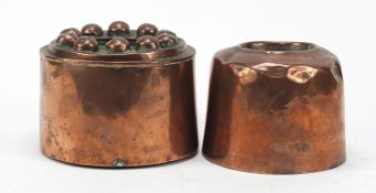 Two 19th century copper jelly moulds, the largest 15cm in diameter