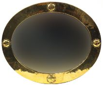 Liberty & Co, Arts & Crafts planished brass and copper mirror with embossed roundels, Liberty London