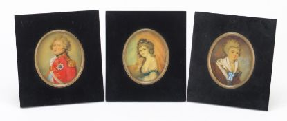 Three oval hand painted portrait miniatures including one of a gentleman in naval dress, each housed