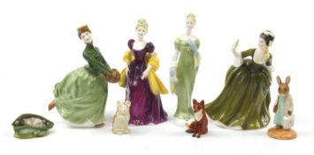 Collectable figures and animals including four Royal Doulton figurines and a Beswick fox, 21.5cm