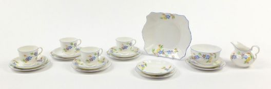 Tuscan teaware including trios hand painted with flowers, sandwich plate, milk jug and sugar bowl,