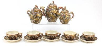 Japanese Satsuma pottery teaware hand painted with one thousand faces, comprising teapot, milk