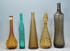 A collection of retro vintage coloured glass bottl