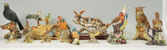 A large collection of Italian ceramic / Capodimonte style bird figurines to include a Viertasca bird