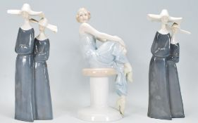 A Royal Doulton figurine of a lady entitled 'Flirtation' HN3071 together with two GDH Lladro style