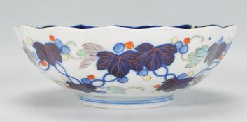 A Chinese blue and white geometric pattern fruit bowl with ironstone red single character mark to