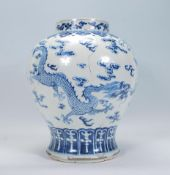 A late 18th / early 19th Century Chinese blue and white glazed bulbous baluster kangxi vase, the