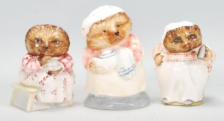 A group of three ceramic Beatrix potter figurines to include Beswick' Mrs Tiggy Winkle' and 'Mrs