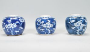 A group of three Chinese blue and white ginger jars of bulbous form and small proportions being hand