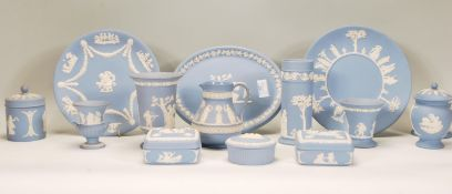 A collection of Wedgwood blue and white jasperware / cameo ceramics to include vases, jug, trinket