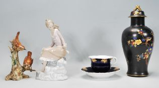 A collection of 20th Century ceramics to include a 1930's Carlton Ware lidded baluster vase having a