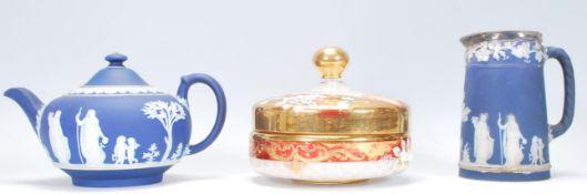 A 19th Century Victorian jasperware tea pot having a cobalt ground with raised white classical