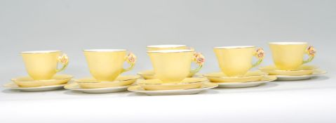 A vintage 20th Century Royal Winton hand painted tea service in the Petunia pattern having yellow