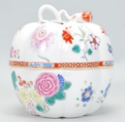 A Chinese export porcelain pumpkin lidded vase decorated in famille rose decoration with embellished