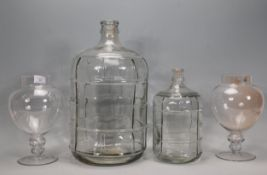 A pair of vintage style pedestal glass sweet jars together with two graduating glass olive / oil